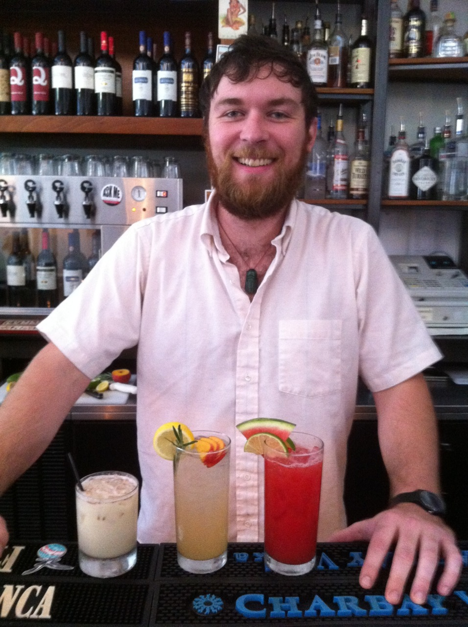 It's too hot! Looking for a thirst quencher? Stay away from soft drinks that tend to dehydrate. Our trusty bartender, Zack Kennedy, poses with three refreshing non-alcoholic drinks. Left to right, horchata (more on that below), lemonade with peach and rosemary, watermelon agua fresca. Horchata Our good friend, Bertis Downs, brought us a sack full of tiger nuts from Valencia, Spain. What are tiger nuts? Well, they're a tuber, not a nut (chufa in Spanish). They're so sought after, they have protected D.O.C. status. The nuts are ground and spiced with cinnamon to make a milky, yet dairy-free, beverage. It's served ice-cold, and wouldn't be bad at all with a splash of dark rum. In this form, it tastes like a light, summery eggnog. We have a limited supply at the moment, but look for it on our menu in the very near future. You may have seen horchata at Mexican restaurants. This is a close cousin, made from rice instead of tiger nuts.