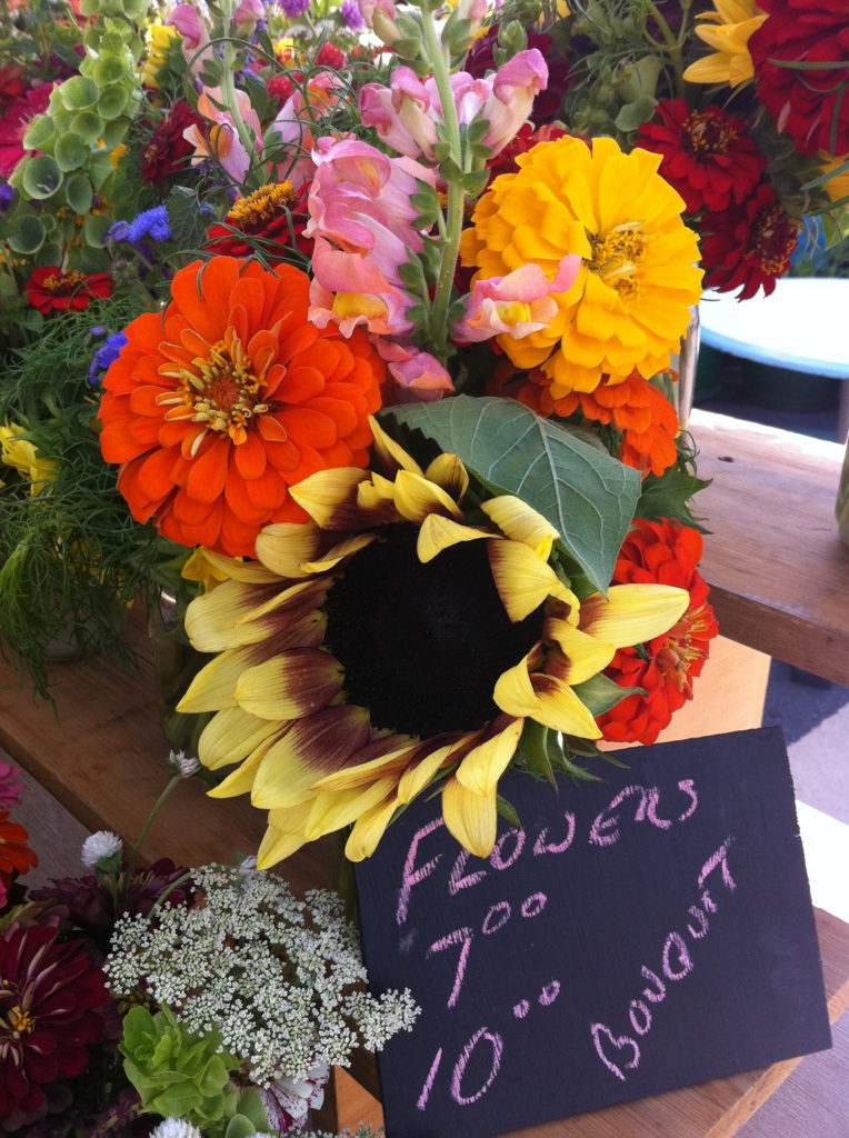 Have you noticed the vibrant flower arrangements brightening our tables? This decorative flora is grown right at Fertile Crescent Farm in Madison County and delivered fresh cut to our door. Stop by the Athens Farmers Market to pick up a bouquet for your home, instantly ready for display in charming mason jars
