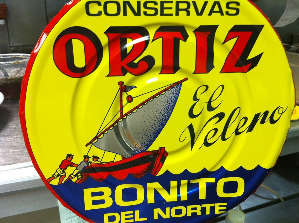 """Ortiz bonito tuna is now at The National Every year Bonito del Norte tuna migrate north as far as the Bay of Biscay in northern Spain. During the summer they fatten up for their return journey south. Just when the tuna are in top shape, fishermen harvest them with rods and live bait from small fishing boats. Within 24 hours they are cooked in seawater and packed by hand in olive oil. The result is the most tender, silky canned tuna in the world. Bonito tuna (aka skipjack tuna) is a Monterey Bay Aquarium Seafood Watch """"Best Choice"""". Look for it as a tapa at dinner, and coming to lunch in the next couple weeks."""