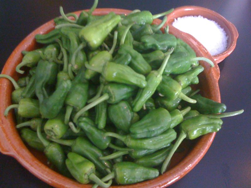 They're here!  First of the season local padron peppers… simply sauteed with olive oil & maldon sea salt, most mild, a few hot, a couple really hot…