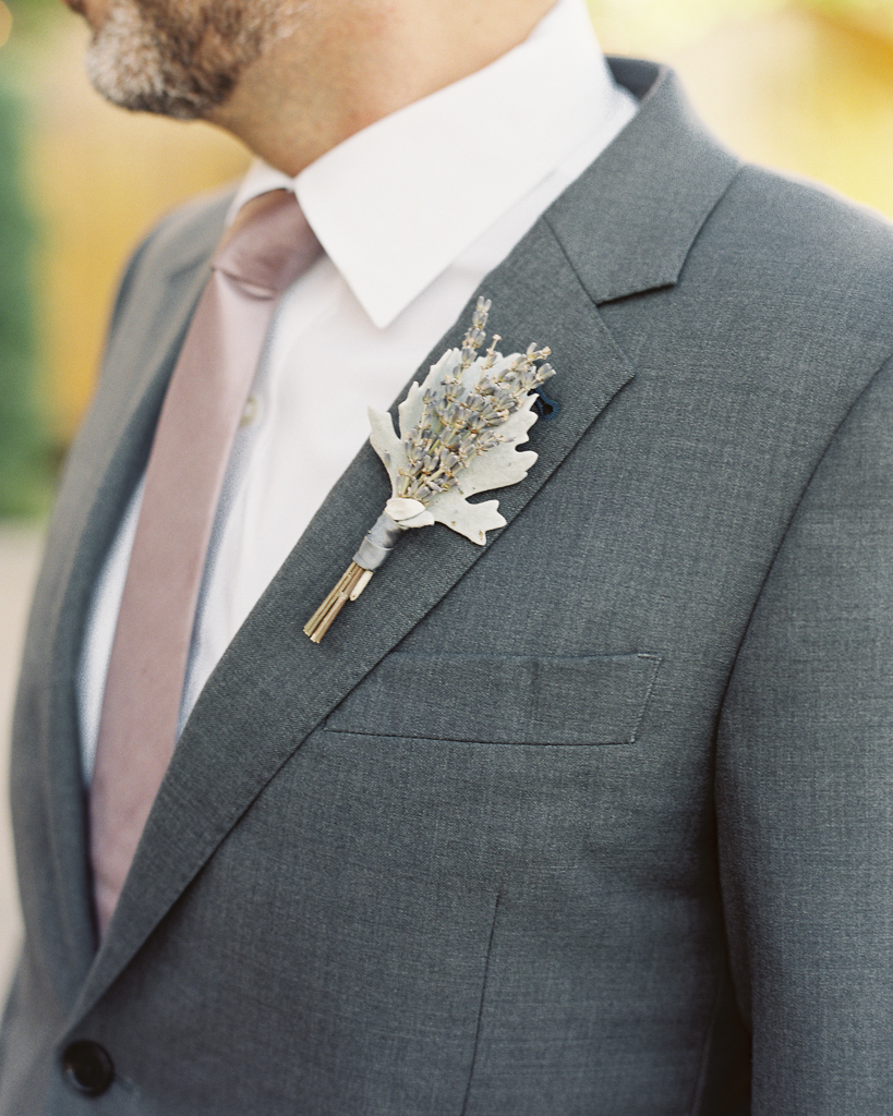 Groomsman with Coral Pink Tie Grey Suit and Rustic Bouitineer