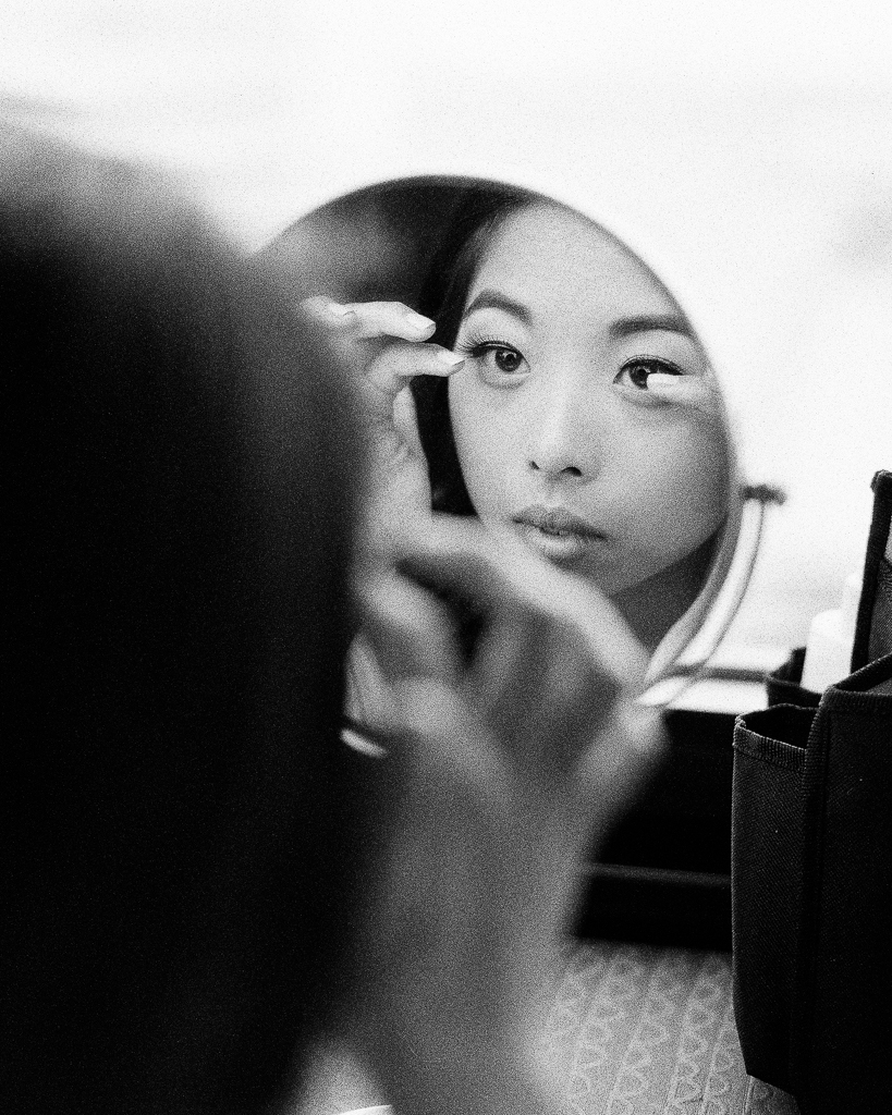 Bride Getting Ready Looking in the Mirror.jpg