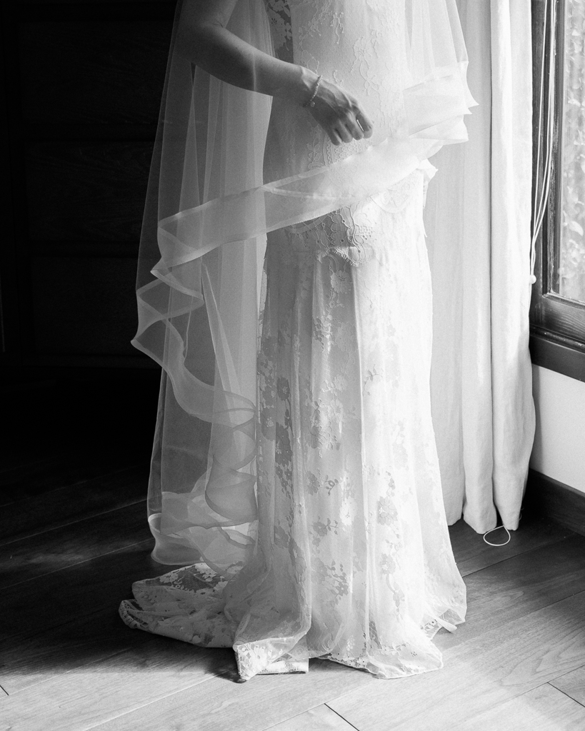 Santa-Barbara-Brides-Dress-Detail-Standing-In-the-Window.jpg