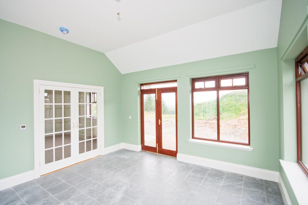Sunroom complete with underfloor heating.