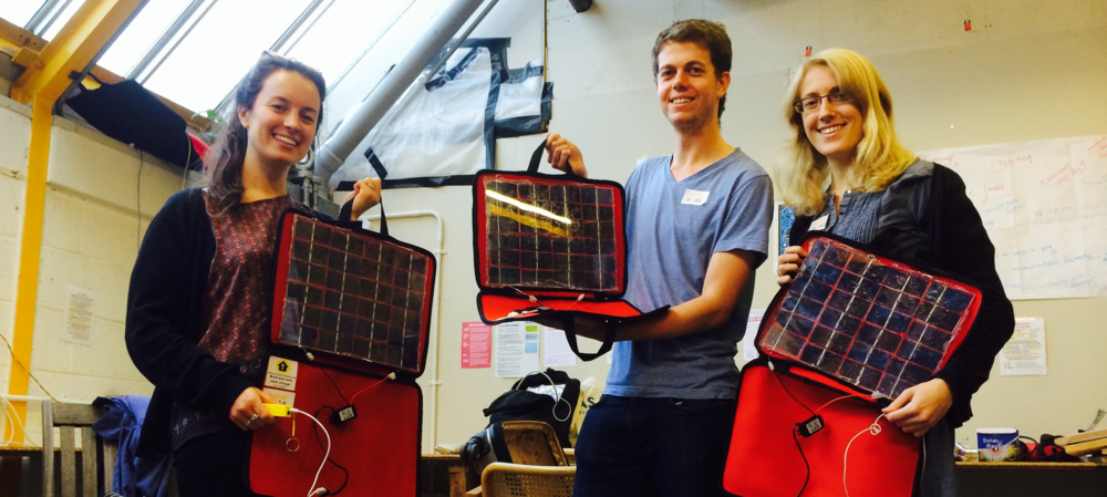 Three of the Solar SOAS team at a workshop on how to make a solar panel charger