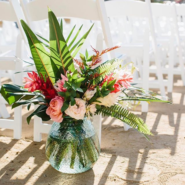 Big colorful arrangements to line the aisle #amidtownwedding #midtowndesign #midtownflorals