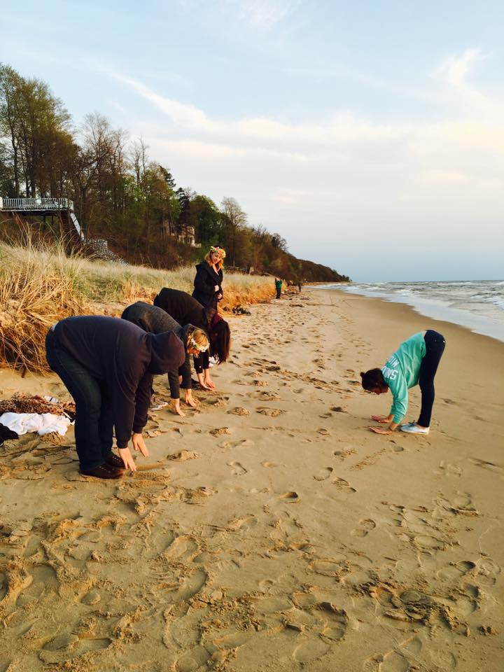Jessica teaching Yoga on the beach to a bunch of people whose sobriety is questionable.