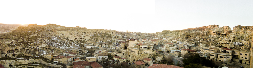 Winter 2006. Ann was living in Turkey and hitchhiking with a friend in Cappadocia. The car dropped them off in Urgup, an ancient but magical city, completely asleep but for the muezzin calling for the evening prayer...