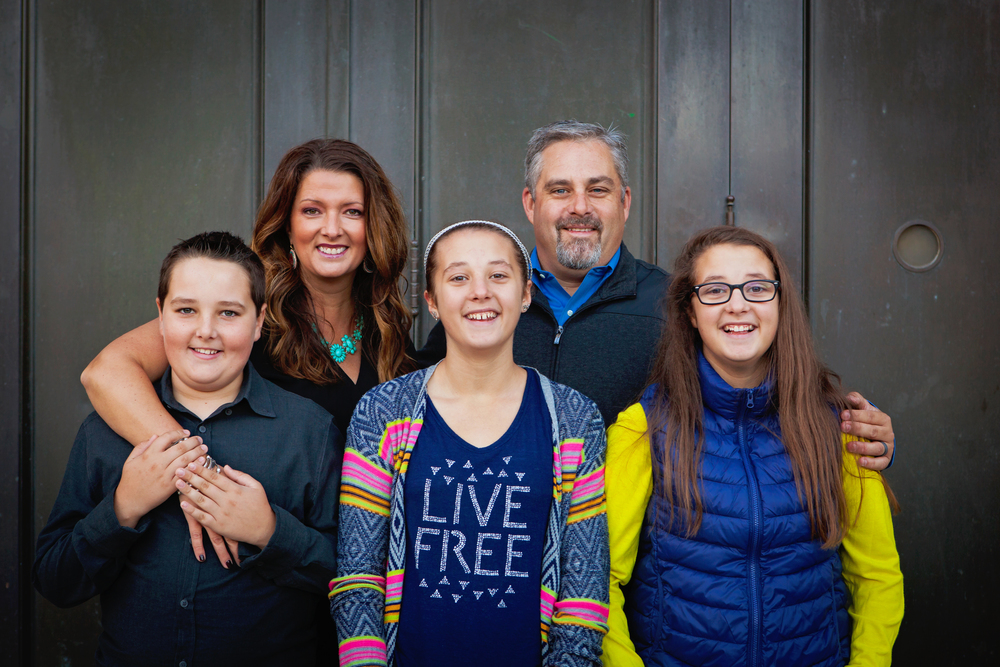 Owner/photographer Kim Dearmore of Kimmel Images, LLC surrounded by her family.