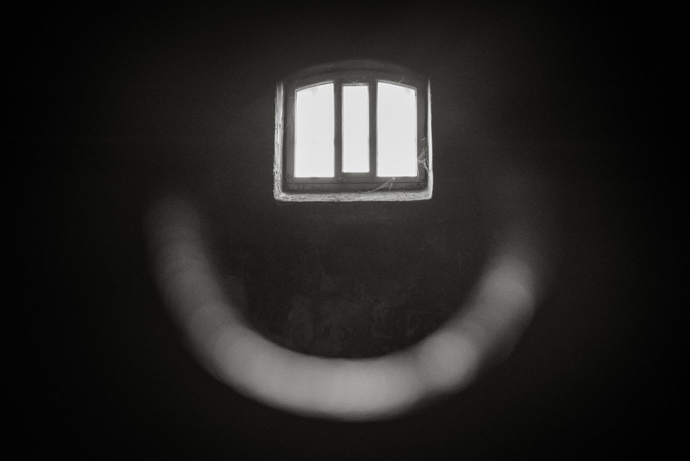 The cells had circular peepholes so guards could check in on prisoners.