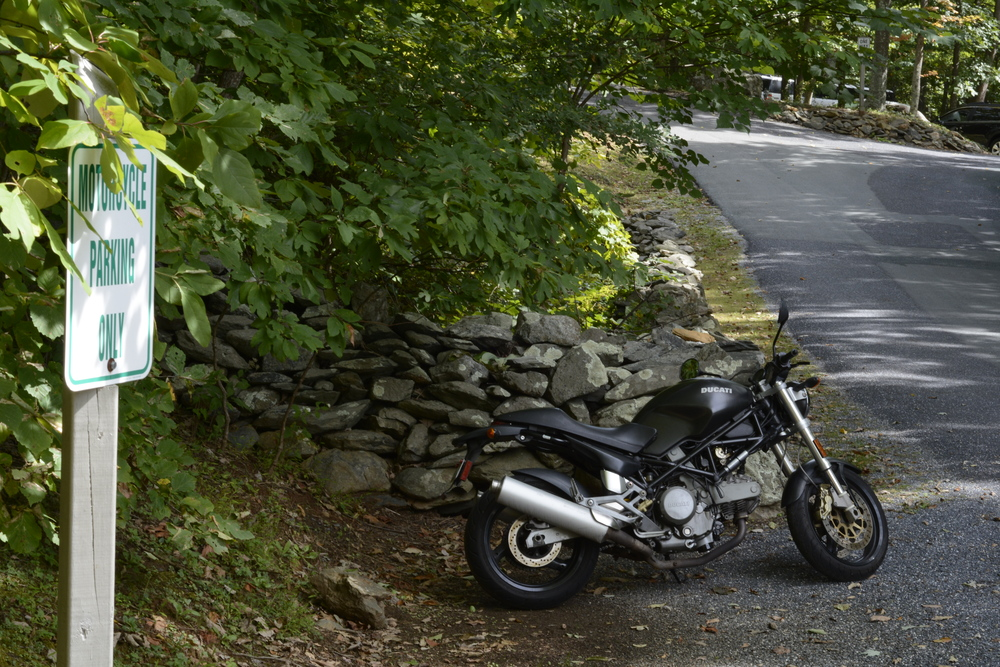 Motorcycle parking is across from the gatehouse at the entrance to Wintergreen.