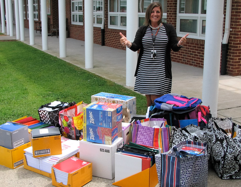 Tye Elementary School Counselor shows off a 2016 donation from the Mountain Homesteaders.
