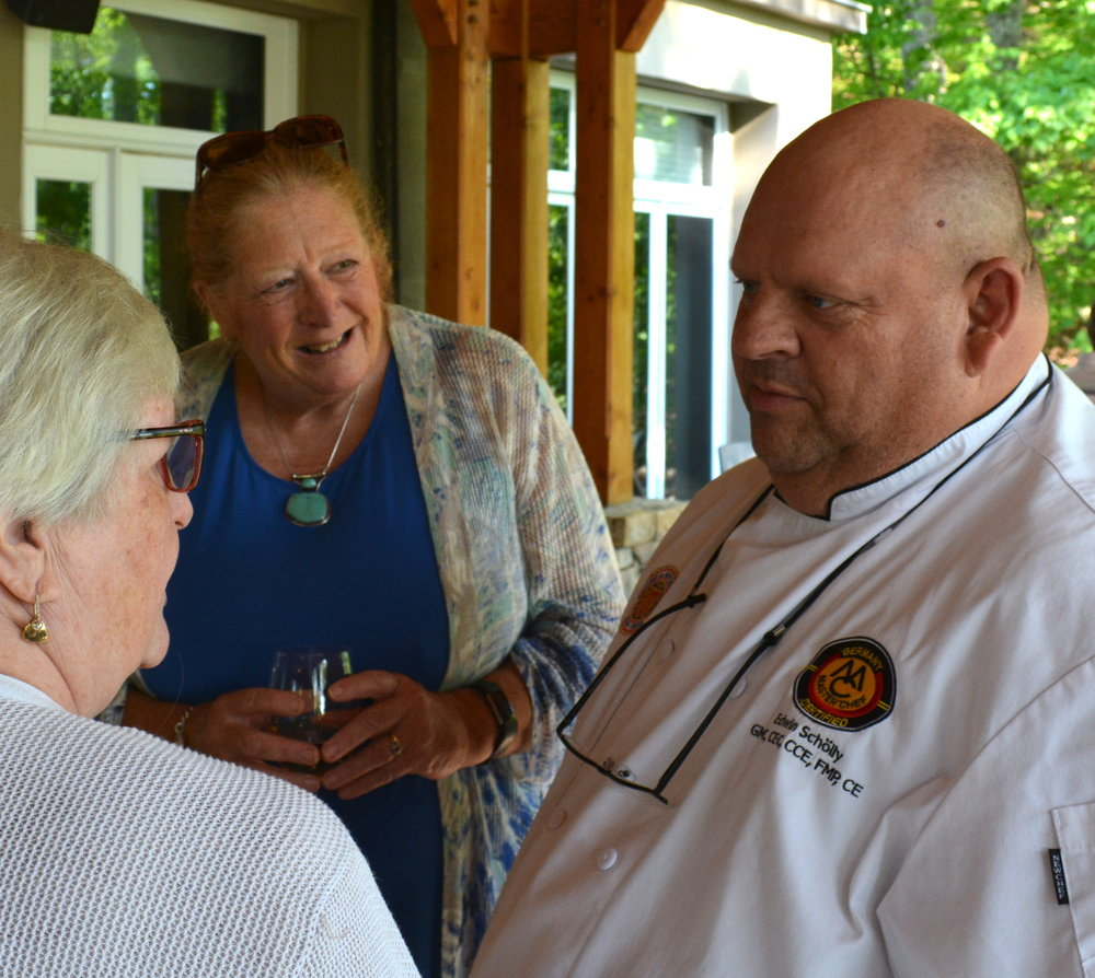 Wintergreen Mountain Homesteaders Social Chair Hilary Partridge (center) and Martha Misker talk with Chef Scholly.