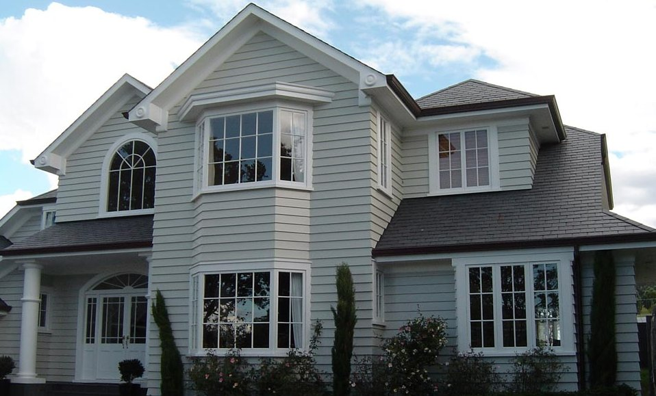 exterior_of_home_grey_siding_white_trim.jpg
