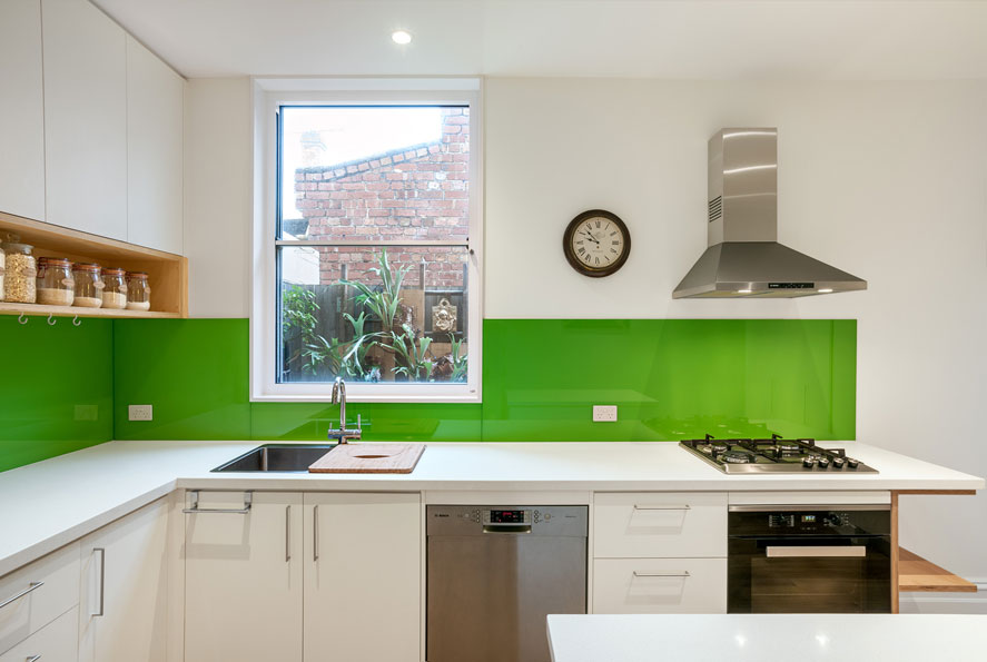 modern kitchen naturally lit garden views shadowline cabinetry glass splashback sustainable architect melbourne brunswick carlton black