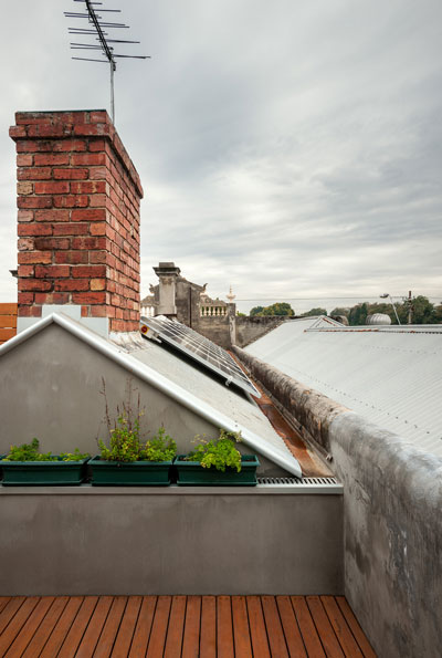 north facing solar panels existing terrace roofline rooftop garden secluded balcony timber decking sustainable architect melbourne green sheep collective black