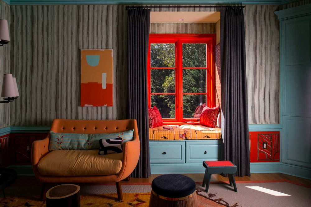 Caryn Cramer's guest room in the 2017 DC Design House in Potomac, Md. features eye-catching orange trim in the window seats and painting by Marta Staudinger. The Sherwin-Williams paint colors in the room include Refresh, Obstinate Orange, Papaya and Cucumber. Cramer is a Washington, D.C. designer. (John McDonnell/The Washington Post)