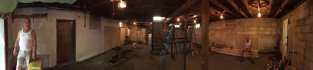 The basement undergoing construction to make way for our new studio!
