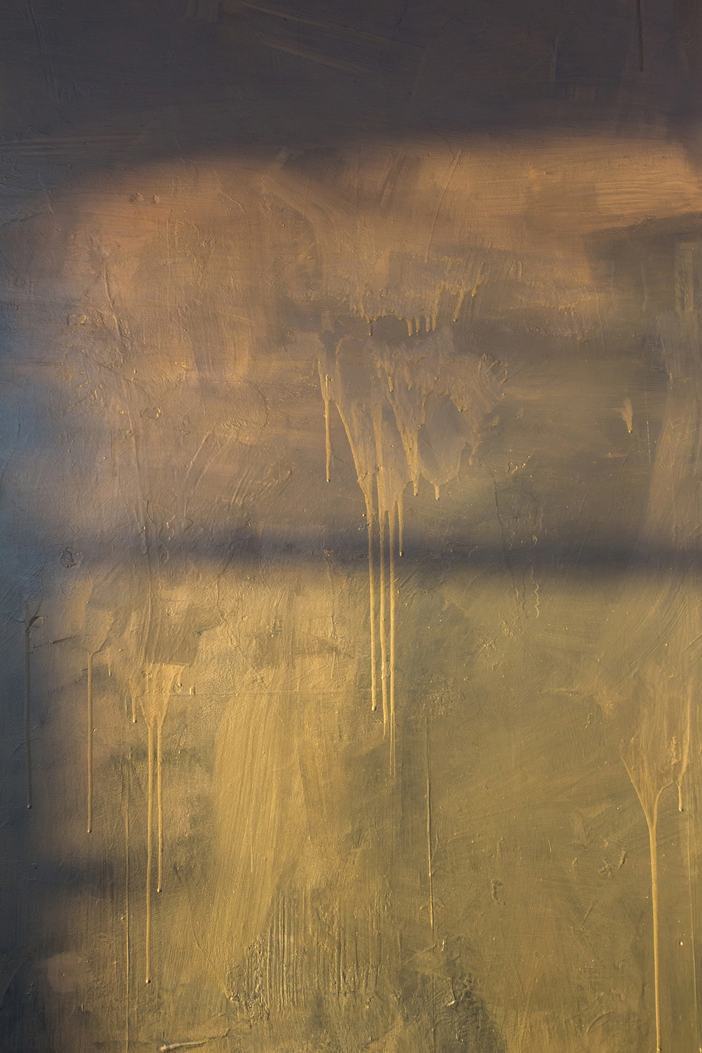 Warm sunlight lights detail of abstract contemporary painting, part of a large scale mural painted in a warehouse like tower, features metallic silver paint and shadows.
