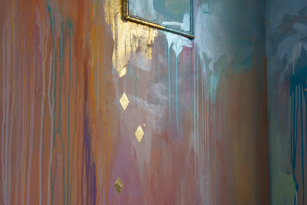 Detail of abstract contemporary painting, part of a large scale mural painted in a warehouse like tower, features gold leaf diamonds and metallic paint.