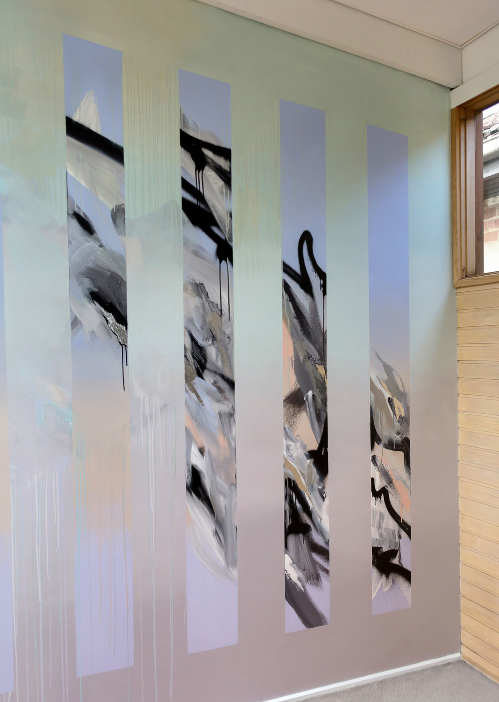 Abstract mural in living room with silver leaf and two different gradients in pastel colors, the contemporary painted design has movement, painted drips and the energy of water.
