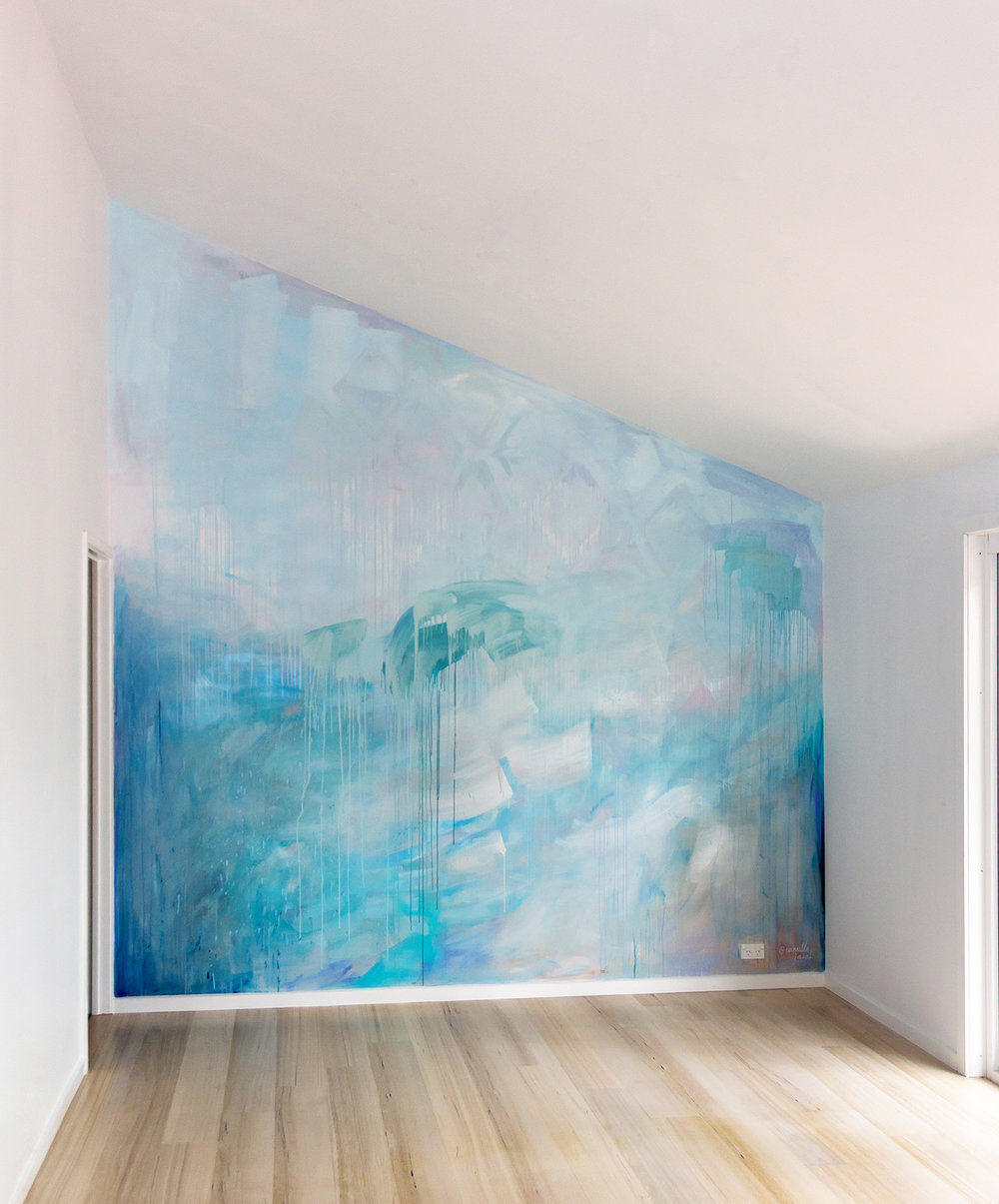 Ocean water painted contemporary abstract mural in pastel blue, green and metallic paint, featuring a wave, drips and geometric shapes, the artwork has movement and reflects light.