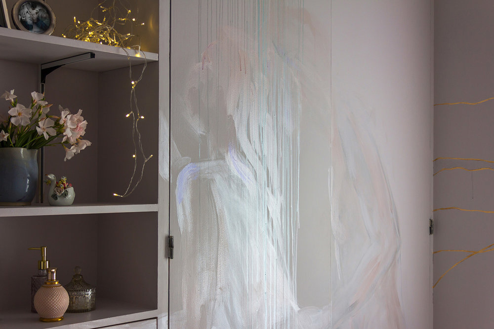 Erotic mural painting of couple having sex, painted on a wardrobe. Metallic paint used which glimmers in the light.