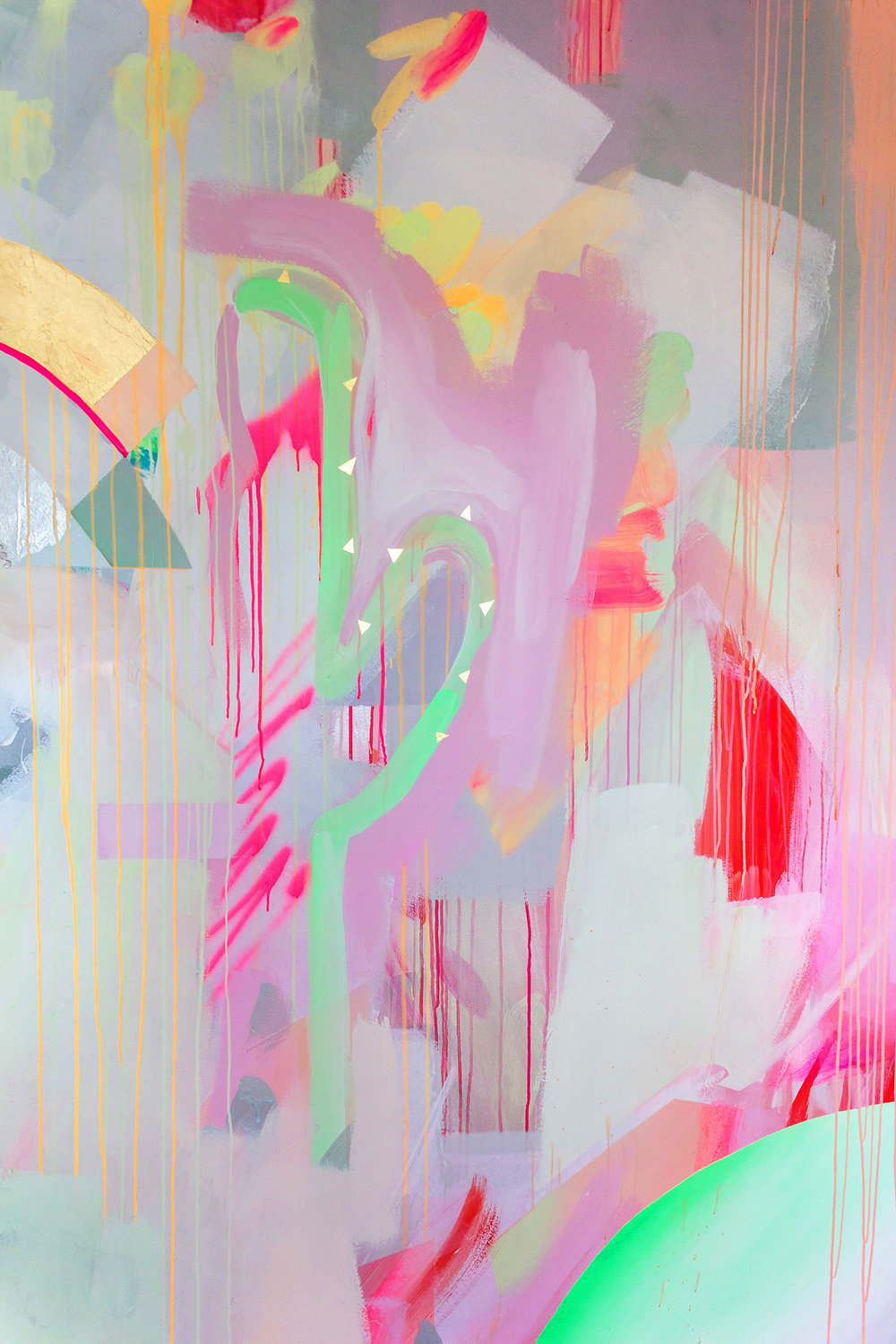 Close up of vibrant galaxy wall mural in bright neon colours, featuring metallic rainbow, spray painted cactus and gold leaf shapes.