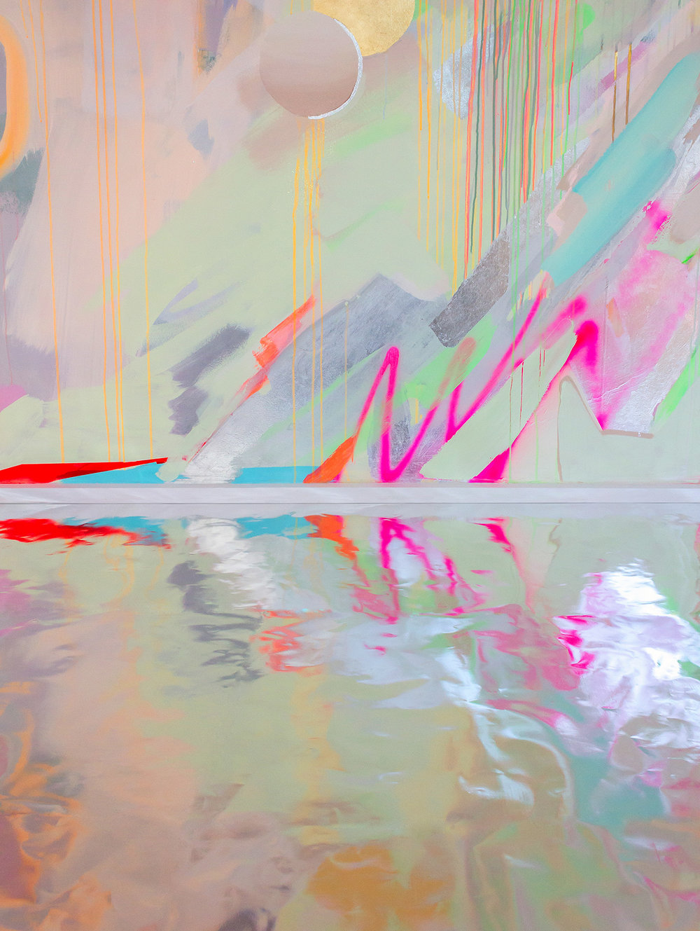 Detail shot of galaxy wall mural in bright neon colours, the silver metallic floor reflects the image.