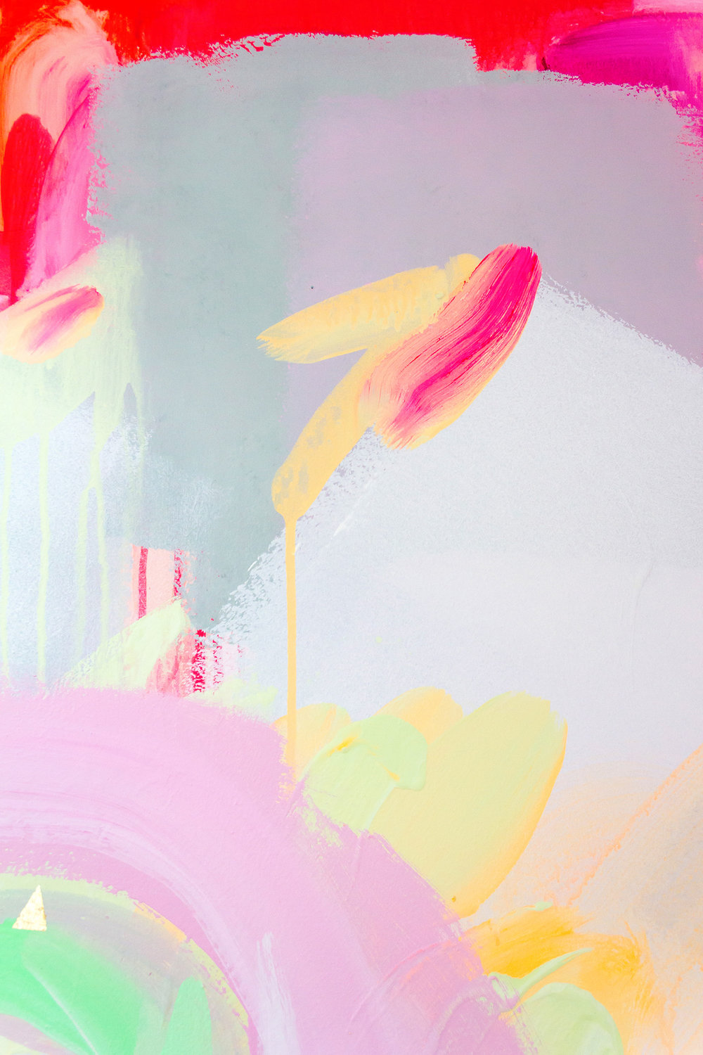 Close up of vibrant wall mural in bright neon colours.