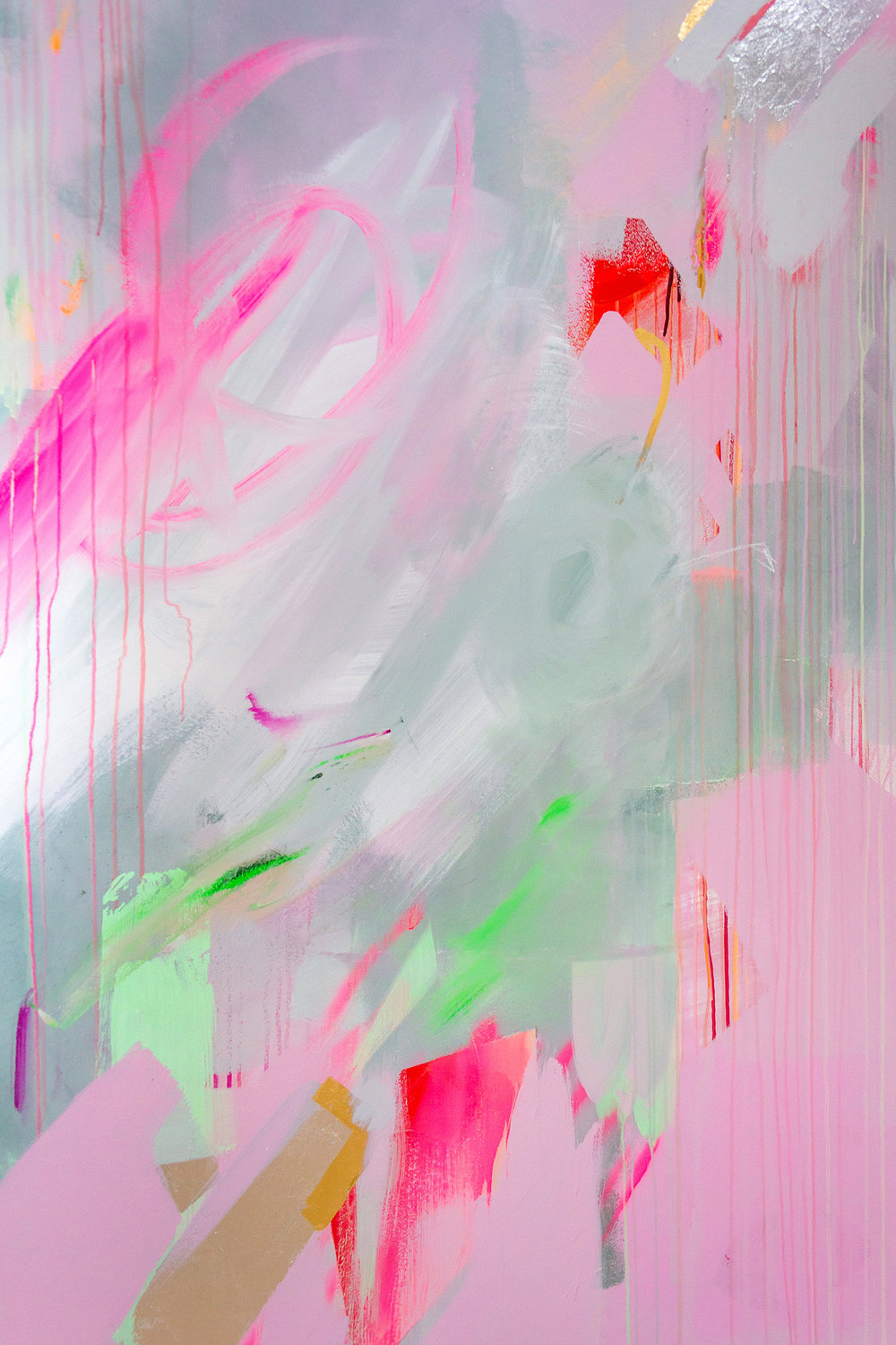 Vibrant abstract mural in pink, green and pastel colours, the energetic brushstrokes resemble a large butterfly.