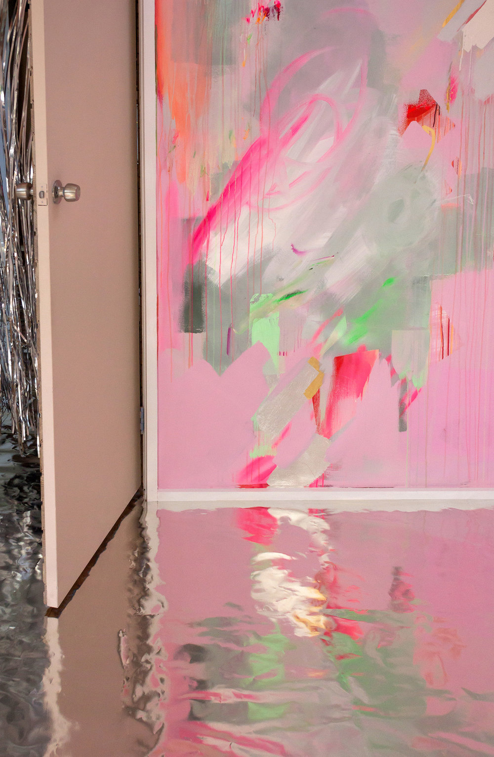 Vibrant abstract mural in pink, green and pastel colours, the energetic brushstrokes resemble a large butterfly A silver metallic curtain flies out from the doorway and silver metallic leaf floor reflects the butterfly.