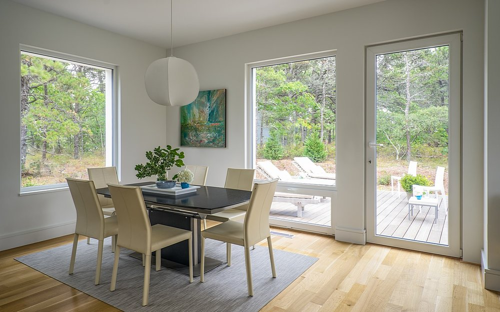 Interior dining space connected to exterior deck