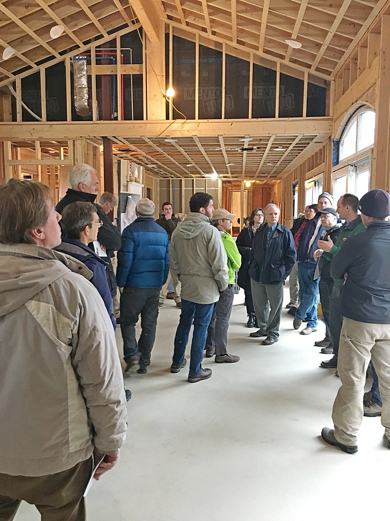 Nick Falkoff, General Manager of Auburndale Builders, explains how his staff implemented the exterior rigid insulation, and when soon combined with cavity insulation, will achieve super-insulation for the home.