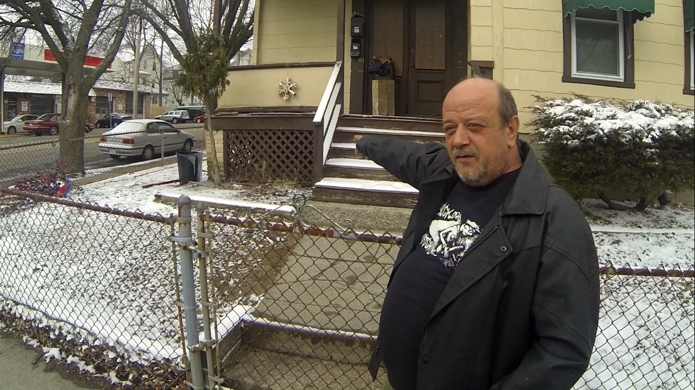 George Thompson shows us the porch of his former apartment where he was arrested