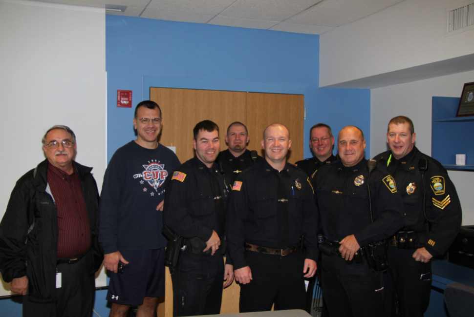 John Vautour with John Bernard (fourth from the left). (Credit: Lynn Police)