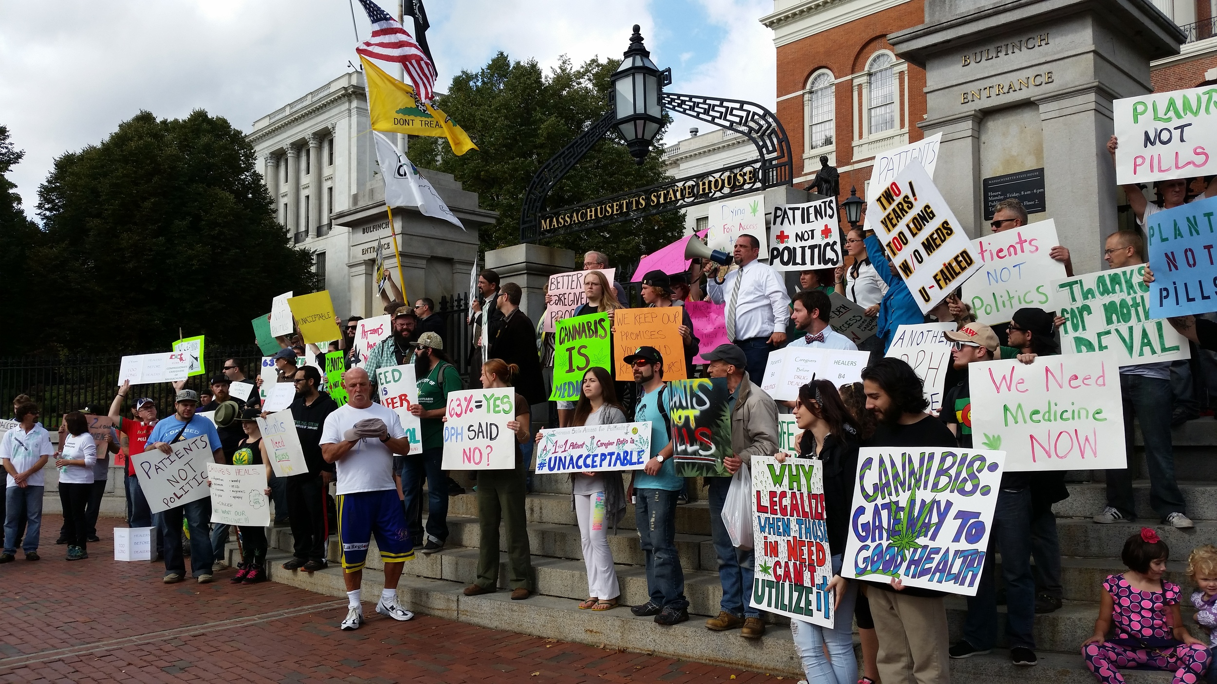 Medical marijuana patients and advocates rally outside the State House.
