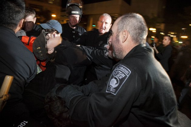 An Occupy Boston protester being choked by a police officer. (Credit: OccupyBoston.org)