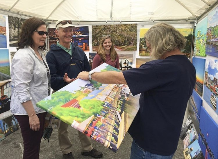 Mike signing a canvas for patrons at the North Carolina Azalea Festival in Wilmington, NC.