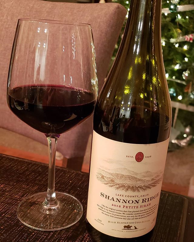 This was named one of the Top 100 wines of the year by Wine Enthusiast, rated at 92 points. We agree. The 2016 Shannon Ridge Petite Sirah is one of those rare, almost perfectly balanced reds. Loads of dark fruit, but not a fruit bomb. Plenty of depth and spice, but not bitter or coarse – everything just works. You'll taste blackberry, blueberry, and plum flavors, followed by a peppery mocha finish, with some dark chocolate undertones. This tastes like a big wine, but it's actually less than 14% alcohol, which we found interesting. Our only critique: the flavors started to fade the more air it got, but the bottle won't last long, so no worries! Best of all: you can find it for as little as $10 a bottle! Recommended. #ShannonRidge #LakeCounty #PetiteSyrah #WineReview