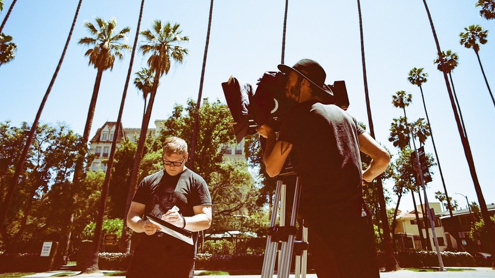 Brandon Scullion (2nd AC) and Kyle Hartman (DP) on set.