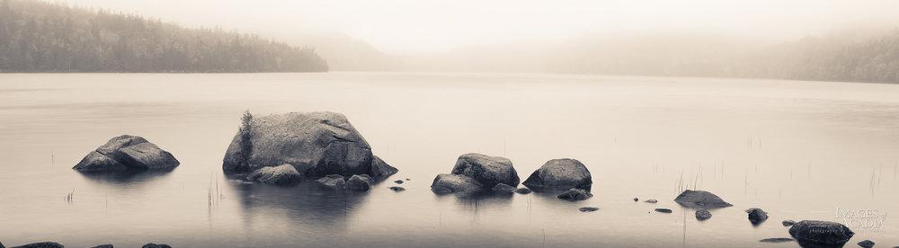 Rocks along the shallow shoreline of Jordan Pond