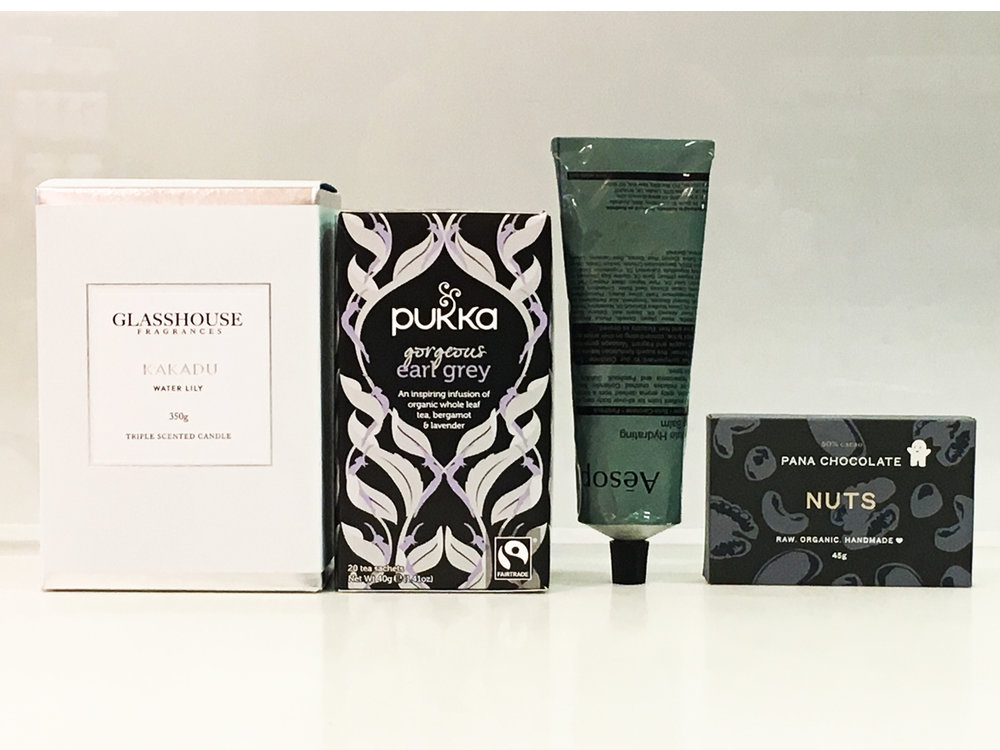 GOING GREY $99    Elegantly boxed premium gift pack includes:   Glasshouse Fragrance Candle 350g, flavour  Pukka Tea 20 tea sachets flavour  Aesop 120ml body balm  Pana Chocolate 45g   * Pana Chocolate has a low melting point, if an issue please ask our consultant for a replacement.   Your Premium brands will be delicately nestled in soft white tissue paper encased in a stunning white matte gift box and white or black satin ribbon.