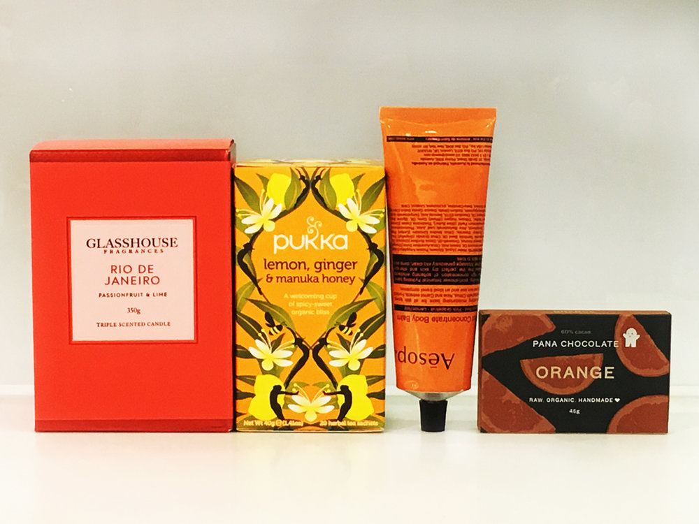 ORANGE IS THE NEW BLACK      $99   Elegantly boxed premium gift pack includes:  Glasshouse Fragrance Candle 350g, flavour  Pukka Tea 20 tea sachets flavour  Aesop 120ml body balm  Pana Chocolate 45g*  * Pana Chocolate has a low melting point, if an issue please ask our consultant for a replacement.  Your Premium brands will be delicately nestled in soft white tissue paper encased in a stunning white matte gift box and white or black satin ribbon.