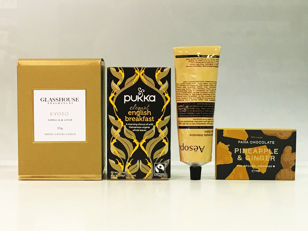 GOOD AS GOLD   $99 Elegantly boxed premium gift pack includes: Glasshouse Fragrance Candle 350g, flavour Pukka Tea 20 tea sachets flavour Aesop 120ml body balm Pana Chocolate 45g * Pana Chocolate has a low melting point, if an issue please ask our consultant for a replacement. Your Premium brands will be delicately nestled in soft white tissue paper encased in a stunning white matte gift box and white or black satin ribbon.