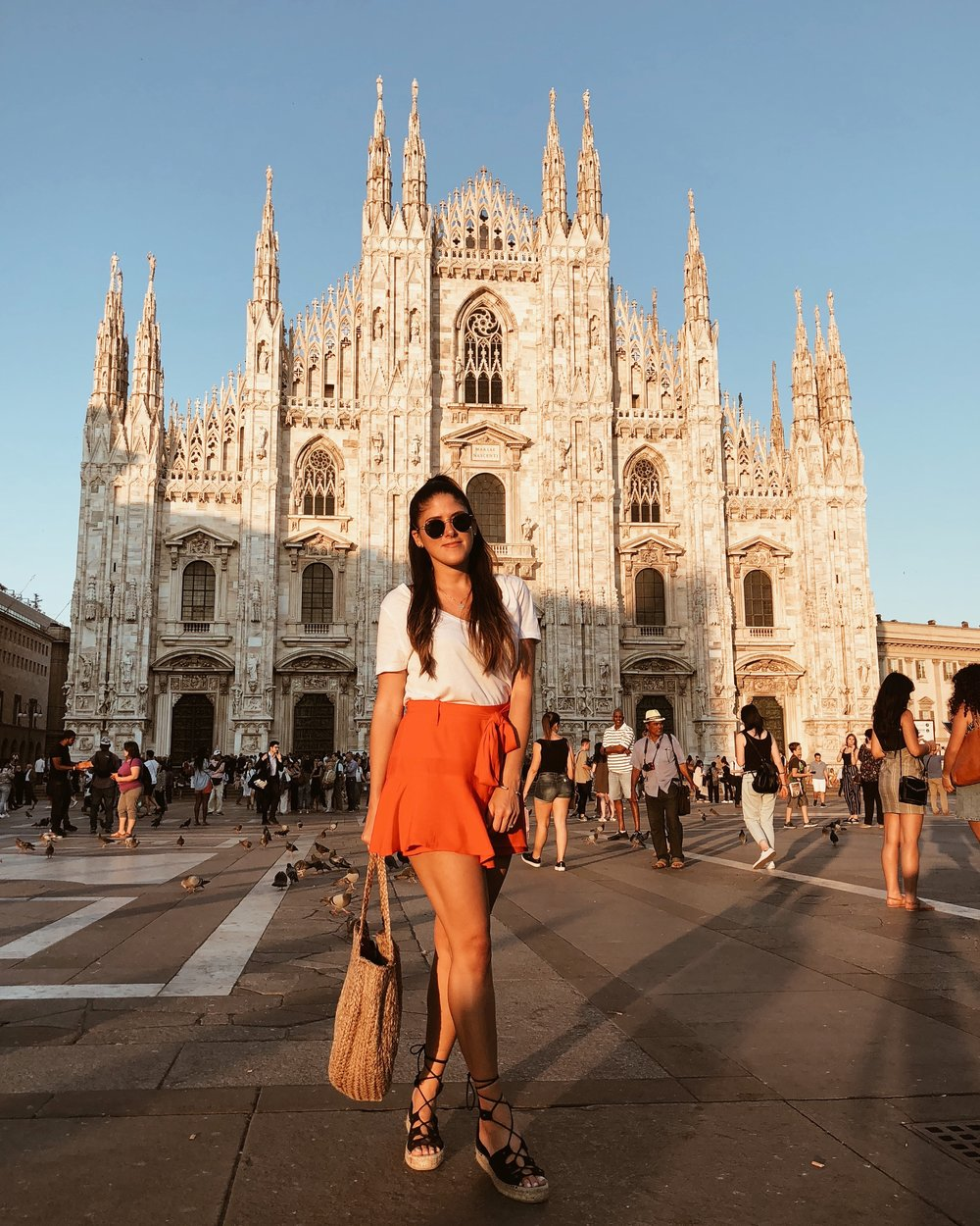Milan, Italy 2018. Paired a white tee with a bright color skirt!