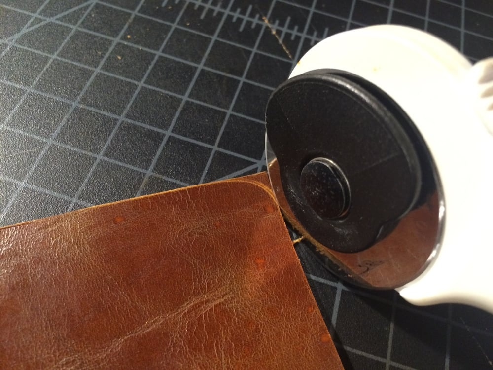 Cut out the piece of leather and leave the corner on (click to enlarge).