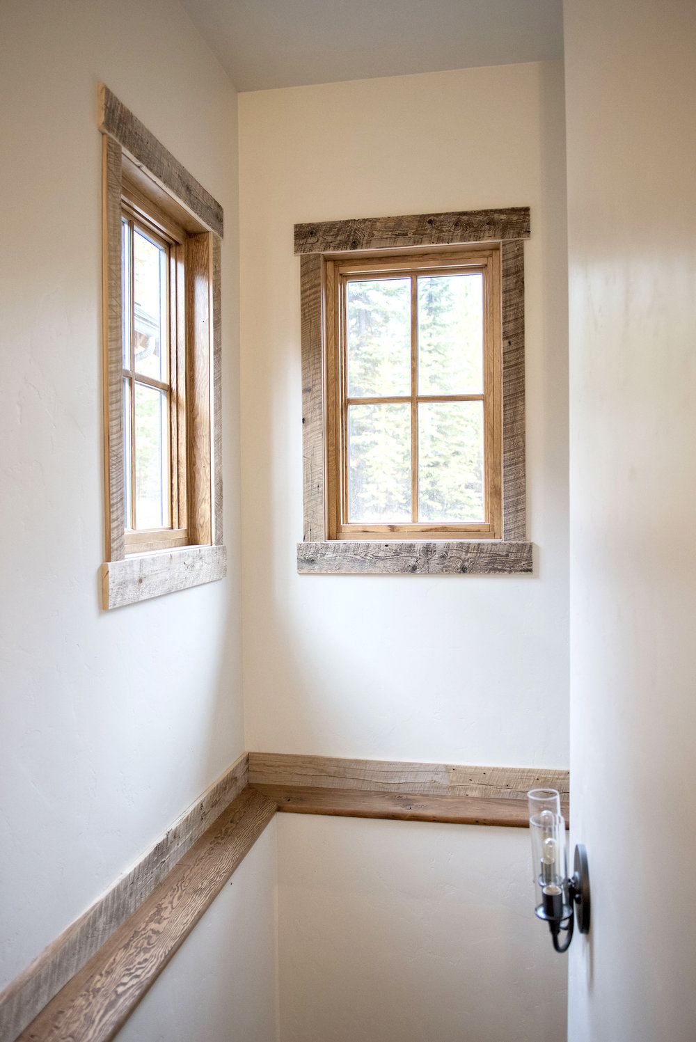 Adding reclaimed trim to interior doors & windows is a simple way to make your space unique or tie in material from an accent wall or ceiling. This trim compliments the material that was used for the ceiling in the main room of the house.