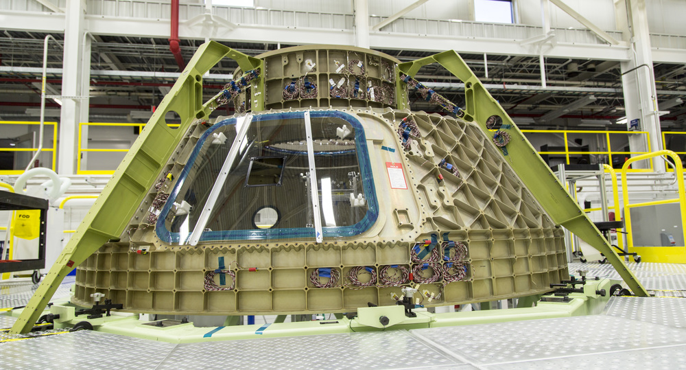 CST-100 Starliner crew capsule is a spacecraft design under construction by Boeing, and it's not planning on hanging out in this hanger much longer.
