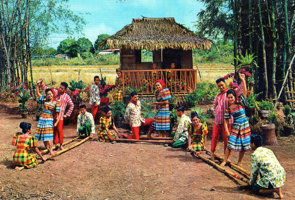 Tinikling - the world famous Philippine dance, imitating the Tikling bird which farmers used to snare because they were seen to be a danger to the crops, dancers hop in and out of bamboo poles to an increasingly frenzied beat. (photo courtesy by: National Bookstore, Manila)